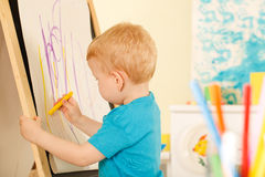 Little genius  with yellow chalk Stock Photo