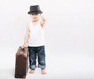 Little gentleman with huge suitcase Stock Photo