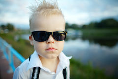 Little gentleman with sunglasses outdoors Royalty Free Stock Photo