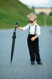 Little gentleman with sunglasses outdoors Royalty Free Stock Image