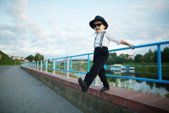 Little gentleman with sunglasses outdoors Stock Images