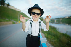 Little gentleman with sunglasses outdoors Royalty Free Stock Photography