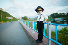 Little gentleman with sunglasses outdoors Stock Photo