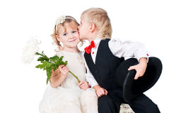 Little gentlemen and lady kissing isolated on whit Stock Images