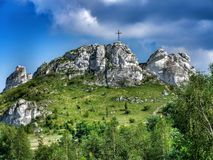 Biaklo - inlier hill located on Cracow - Czestochowa upland in Poland. Little Giewont inlier hill with metal cross located in the Sokole Mountains reserve in royalty free stock photography
