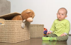 Little gift 4. A very cute 8-9 months old baby is playing with teddy bears in a basket. This is a full series of 14 photos, take a look at them all before you Royalty Free Stock Photography