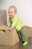 Little gift 5. A very cute 8-9 months old baby is playing with teddy bears in a basket. This is a full series of 14 photos, take a look at them all before you Stock Photo