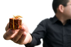 Little gift. Man handing over a tiny gift Royalty Free Stock Image