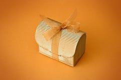Little gift. Isolated on orange background Stock Photos