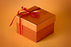 Little gift. Isolated on orange background Stock Image
