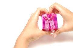 Little gift box in hands Stock Image