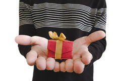 Little gift box on hands, shallow depth of field, selective focus on gift box, isolated on white background. Little gift box on hands, shallow depth of field stock photography