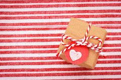 Little gift box with heart shaped tag Stock Photography