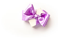 Little gift box with purple bow Royalty Free Stock Photography