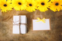 Little gift box with with yellow flowers Stock Images