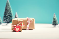 Little gift boxes in miniature evergreen forest. Little handmade gift boxes in a snow covered miniature evergreen forest Royalty Free Stock Photography
