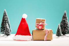 Little gift boxes in miniature evergreen forest Royalty Free Stock Photo