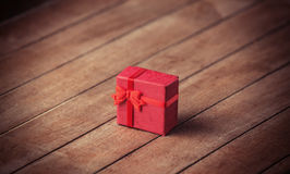 Little gift on wooden table. Royalty Free Stock Image