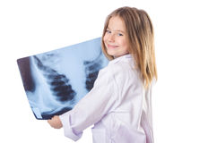 Little gilr playing doctor Royalty Free Stock Photos