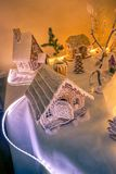 gingerbread houses on a backlit table stock photos