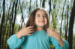 Little gir. Portrait of the beautiful little girl with long hair in forest Royalty Free Stock Image