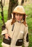 Little gir. L plays autumn park Royalty Free Stock Photography