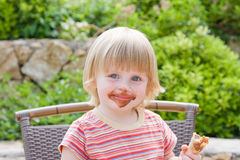 Little girl. Young girl eating in restaurant Royalty Free Stock Images