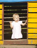 Little girl. The little happy girl in rose dress. Playing in little house Stock Photography