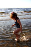 Little girl. The little girl ran on a sea royalty free stock photography