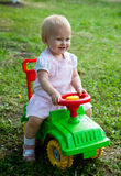 Little girl. Sitting on a green car Stock Photo
