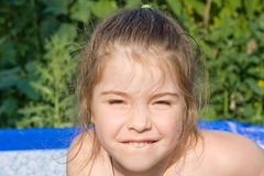 Little girl. In the swimming pool Royalty Free Stock Image
