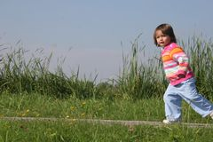 Little Girl. Running Royalty Free Stock Image