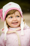The little girl. The little beautiful girl smiles Royalty Free Stock Photos