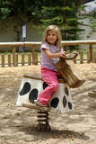 Little girl. The little girl on the horse stock photo