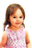 Little girl. In pink dress smiling Stock Image