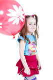 Little girl. With red balloon Stock Photos