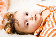 Little girl. Is lying on the bed Stock Photo