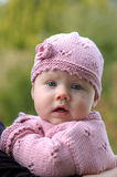 Little girl. In nice pink knitware stock photos