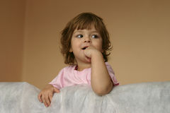 Little girl. Kid looking with surprise and smiling Royalty Free Stock Images