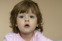 Little girl. Sad kid, looking with expectation, with disheveled hair Stock Photo