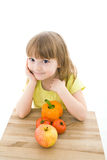 Little girl. The portrait of a cute little girl holding fresh vegetables Stock Photos