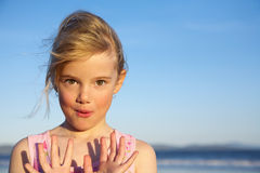 Little girl. With hands up facing camera royalty free stock photo
