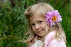 The little girl. With a flower in hair Royalty Free Stock Photo