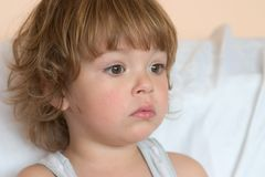 Little girl. Portrait of a little, cute girl, looking sad Stock Photography