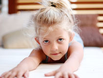 Little girl. Laying on tummy arms stretched out Stock Photography