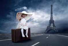 Little girl. Waiting on the road with her vintage baggage Stock Photos
