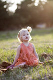 A little girl. A portrait of a little girl with a flower in her hair Stock Photos