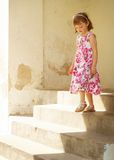 Little girl. Walking down steps Royalty Free Stock Photography