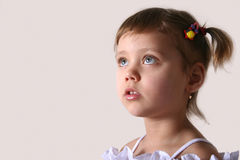 Little girl. Look in up, close-up Stock Photo