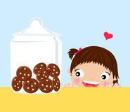 Little girl. Looking at cookies in a jar Stock Image